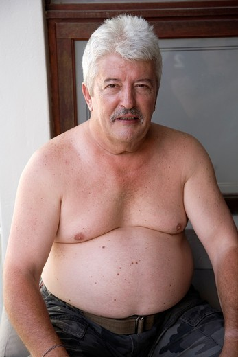 Stock Photo: 1566-787481 Overweight male with bare upper torso
