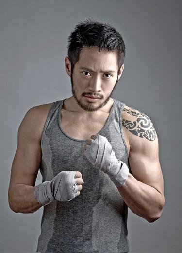 Chinese Kick Boxer with Tattoo : Stock Photo