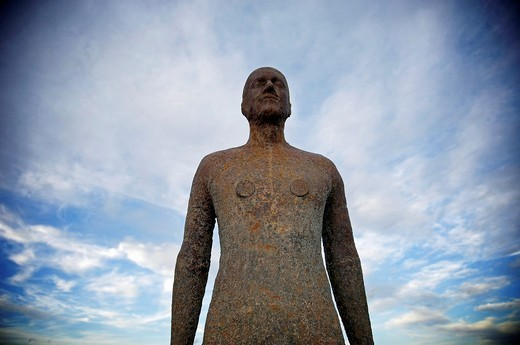One of artist Anthony Gormley´s 100 statues covering three by one kilometres of Croston beach, Merseyside : Stock Photo