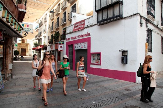 Stock Photo: 1566-790579 Tourists walking down a street in Cordoba, Andalusia, Spain