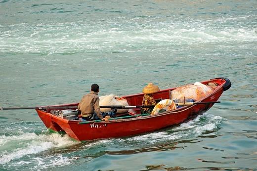 Stock Photo: 1566-791152 People on a small boat heading towards Victoria Harbor, Hong Kong, China
