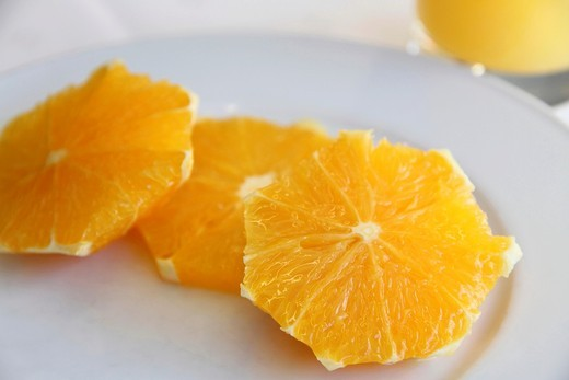 Slices of orange fruit and orange juice : Stock Photo