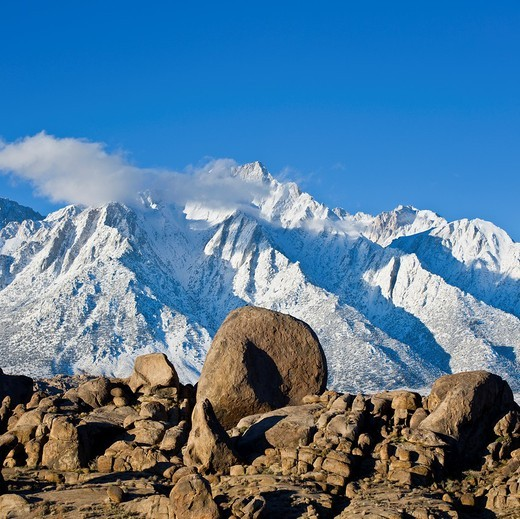 Stock Photo: 1566-792337 Granite rock formations of Alabama Hills with Lone Pine peak and Sierra Nevada mountains in background, California