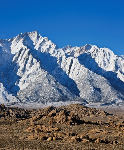 Granite rock formations of Alabama Hills with Lone Pine peak and Sierra Nevada mountains in background, California : Stock Photo