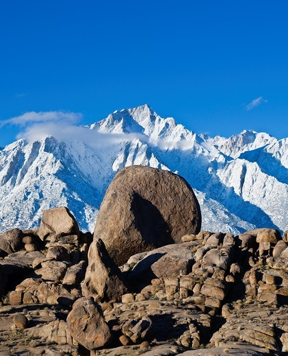 Stock Photo: 1566-792347 Granite rock formations of Alabama Hills with Lone Pine peak and Sierra Nevada mountains in background, California