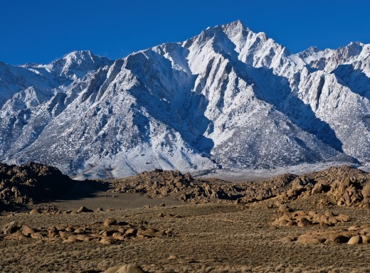 Stock Photo: 1566-792348 Granite rock formations of Alabama Hills with Lone Pine peak and Sierra Nevada mountains in background, California