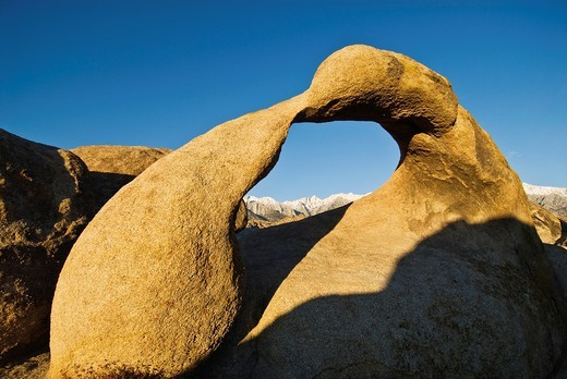 Mobius Arch in the Alabama Hills provides view of Sierra Nevada Mountains  Near Lone Pine, California : Stock Photo