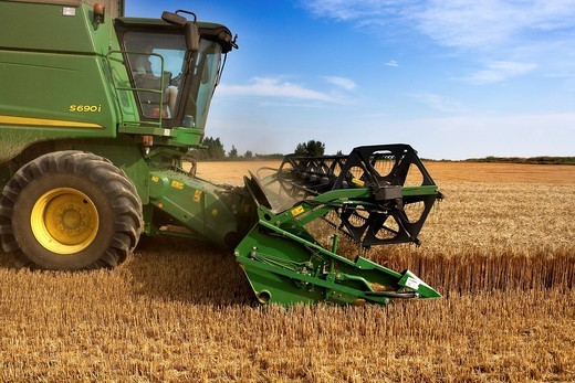 Stock Photo: 1566-793171 Reaping machine in a Wheat field  LLeida, Spain
