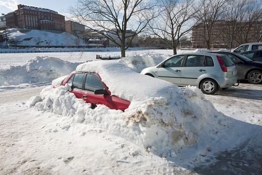 Stock Photo: 1566-793879 red car buried in snow Helsinki Finland