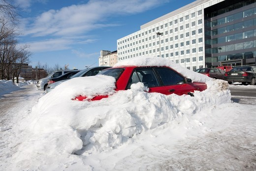 red car buried in snow Helsinki Finland : Stock Photo