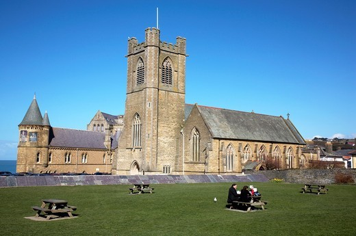 Having a picnic outside St Michael`s Church and old university buildings in Aberystwyth Ceredigion Wales UK : Stock Photo