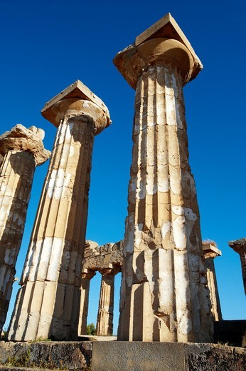 Greek Dorik columns at the ruins of Temple F at Selinunte, Sicily : Stock Photo
