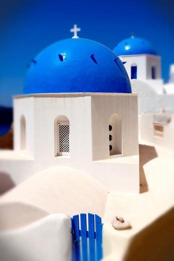 Oia, Island Santorini - Blue domed Byzantine Orthodax churches, - Greek Cyclades islands : Stock Photo