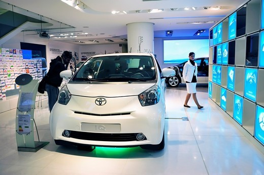 Paris, France, Man Shopping in New Car Showroom, Toyota Car, IQ, Hybrid Engine : Stock Photo