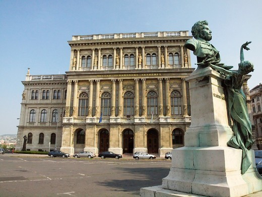 Stock Photo: 1566-796933 Statue of Gábor Szarvas in front of the Hungarian Academy of Sciences , Budapest. Statue of Gábor Szarvas in front of the Hungarian Academy of Sciences  Magyar Tudományos Akadémia  The statue and Academy are located at Roosevelt Square near the eastern side of the Chain Bridge in Budapest  Szarvas was involved in linguistics in the 19th century