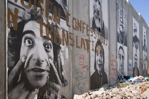 A group of posters on the controversial ´security fence´, a wall built by the Israelis to separate themselves from the Palestinians : Stock Photo