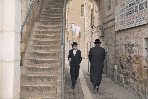 Orthodox jews walking in the Mea Sharim area of Jerusalem, Israel : Stock Photo