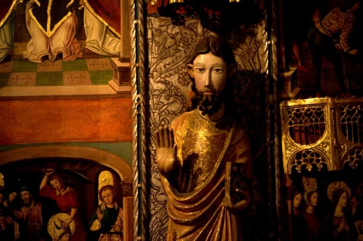 A sculpture of one apostle saluting with his hand is displayed in an altarpiece in the Museum of the Cathedral of Astorga, Spain. Astorga is one important stop for pilgrims traveling in the French way of the Way to Saint James : Stock Photo