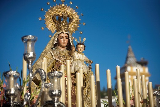 Stock Photo: 1566-798737 A wooden statue of the Virgin Carmen is publicly displayed during a Holy Week procession in the town of Prado del Rey in southern Spain´s Cadiz Sierra region in Andalucia, April 24, 2011  Easter processions in Andalucia during Holy Week are a public displ. A wooden statue of the Virgin Carmen is publicly displayed during a Holy Week procession in the town of Prado del Rey in southern Spain´s Cadiz Sierra region in Andalucia, April 24, 2011  Easter processions in Andalucia during Holy Week are a
