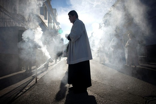 An acolyte spreads incense during an Easter Holy Week procession in Prado del Rey, Andalusia, Spain, April 24, 2011 : Stock Photo