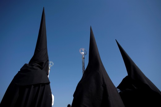 Stock Photo: 1566-798826 Penitents of the Jesus del Silencio brotherhood, known as the Brotherhood of Love perform in an Easter Holy Week procession in Cordoba, Andalusia, Spain, April 17, 2011