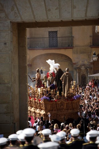 The Jesus del Silencio brotherhood throne crosses the Gate of the Roman Bridge, also known as the Arch of the Triumph during an Easter Holy Week procession in Cordoba, Andalusia, Spain, April 17, 2011 : Stock Photo