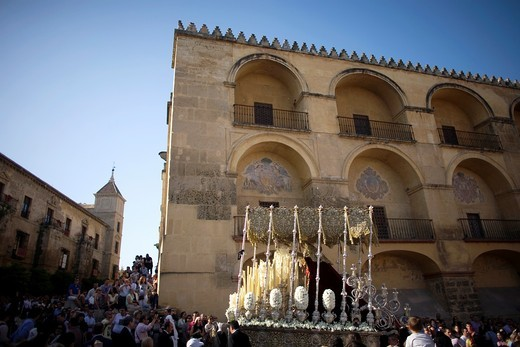 Stock Photo: 1566-798831 The Brotherhood of Love displays the Virgen de la Encarnacion throne in front of the Mosque Cathedral exterior during an Easter Holy Week procession in the Plaza del Truinfo, Cordoba, Andalusia, Spain, April 17, 2011