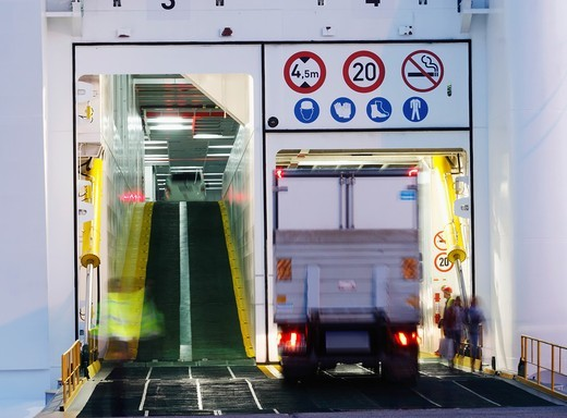 Stock Photo: 1566-798903 Truck boarding Naviera Armas ferry In Puerto de La Luz, Las Palmas, Gran Canaria  Destination, Huelva, Spain