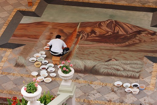 Creating Corpus Christi carpet using only natural coloured earth from nearby Teide national park in Plaza del Ayuntamiento, La Orotava, Tenerife, Canary Islands, Spain : Stock Photo