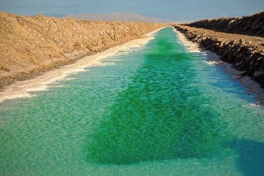 Stock Photo: 1566-799103 Green canals of liquid Calcium Chloride drying in the desert outside Amboy, CA