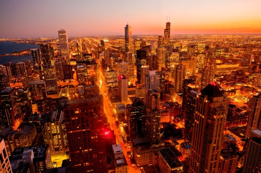 Sunset over the Chicago skyline looking south from the Hancock Tower along the lake front in Chicago, IL, USA : Stock Photo