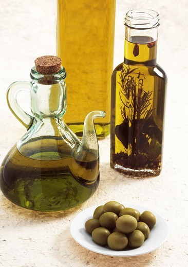 Stock Photo: 1566-799287 OLIVE OIL BOTTLE, AND GREEN OLIVES olea europaea