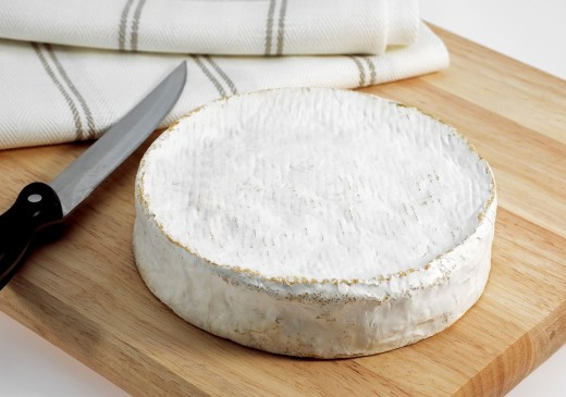 French Cheese called Coulommiers, Cheese made with Cow´s Milk : Stock Photo