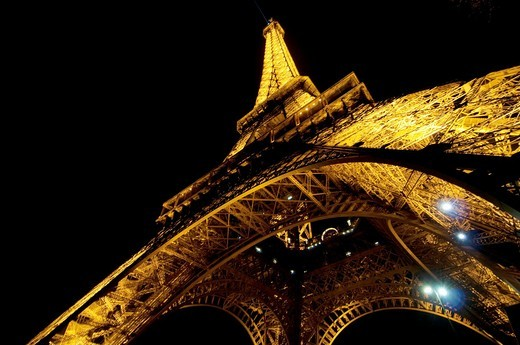 Eiffel Tower, Paris, France  Located on the Champ de Mars in Paris, it is a puddle iron lattice tower built in 1889, a global icon of France and one of the most recognizable structures in the world : Stock Photo
