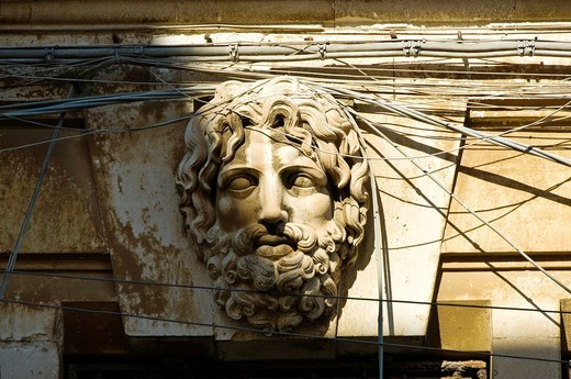 Classical style head and tangle of electrical wires, Siracusa, Sicily : Stock Photo