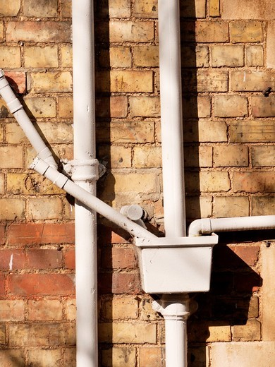 Ironwork drainage pipes on Victorian building, Oxford, UK : Stock Photo