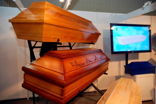 Stock Photo: 1566-804971 One of the wooden coffins producer stand on ´Memento´ Funeral Expo in Warsaw, Poland