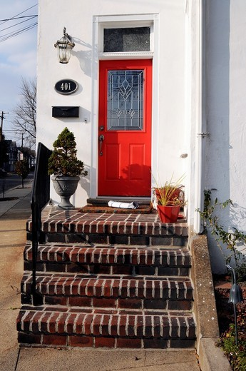 Red door and porch, Bristol, Bucks County, Pennsylvania,USA,North America,US : Stock Photo