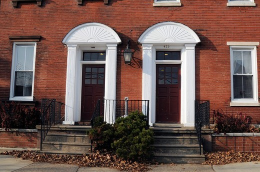 Old building with two white decorated door, Bristol, Bucks County, Pennsylvania,USA,North America : Stock Photo