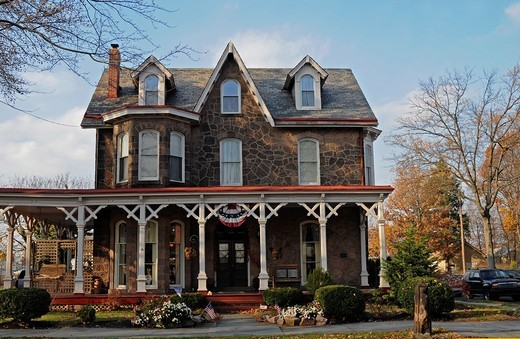 Stock Photo: 1566-804998 Old building in Victorian style with big wooden terrace, Bristol, Pennsylvania, USA