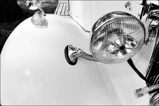 Stock Photo: 1566-805173 Detail of front luxury white antique car with wing and headlight