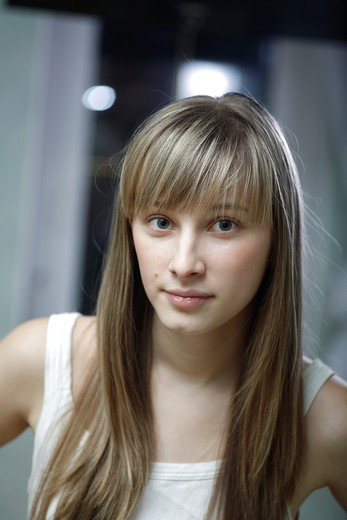 Stock Photo: 1566-806786 headshot of the pretty blond women weared tank top indoors front view Caucasian, 24 years old