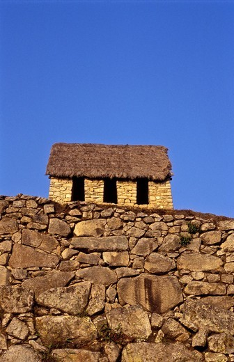 Stock Photo: 1566-807000 Little stone hut with a thatched roof at Machu Picchu, Peru