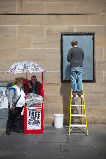 Street scene including a newspaper vendor, an obese woman and a billposter, Sauchiehall Street, Glasgow : Stock Photo