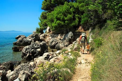 Tourists walking to Zivogosce Mala Duba villlage, Croatia : Stock Photo