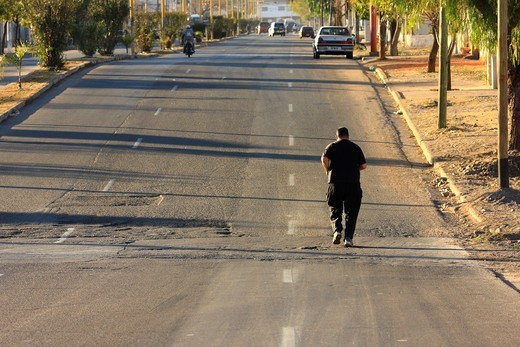 A man practising jogging in the street of Chilecito in Argentina : Stock Photo