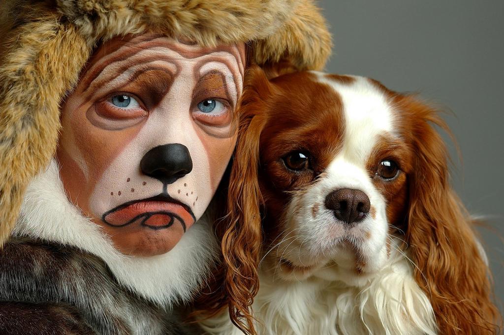 Girl dressed like her dog, King Charles Cavalier : Stock Photo