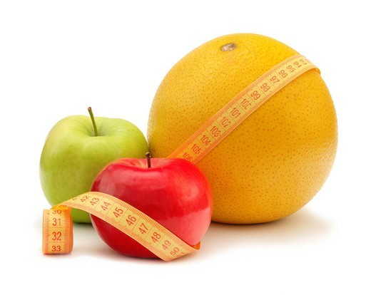 Fruits with measuring instrument on a white background : Stock Photo