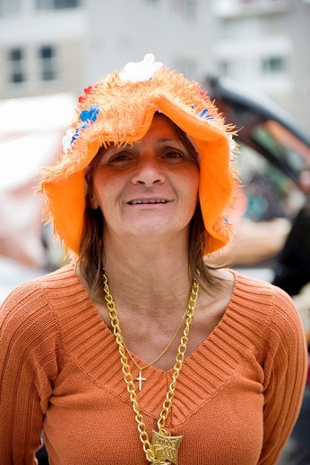 All kinds of people dress in orange clothes during Queensday in the Netherlands : Stock Photo