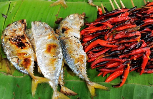 two head fish bbq and chilli bbq on banana leaves , for sale at klong toei market , bangkok , thailand : Stock Photo